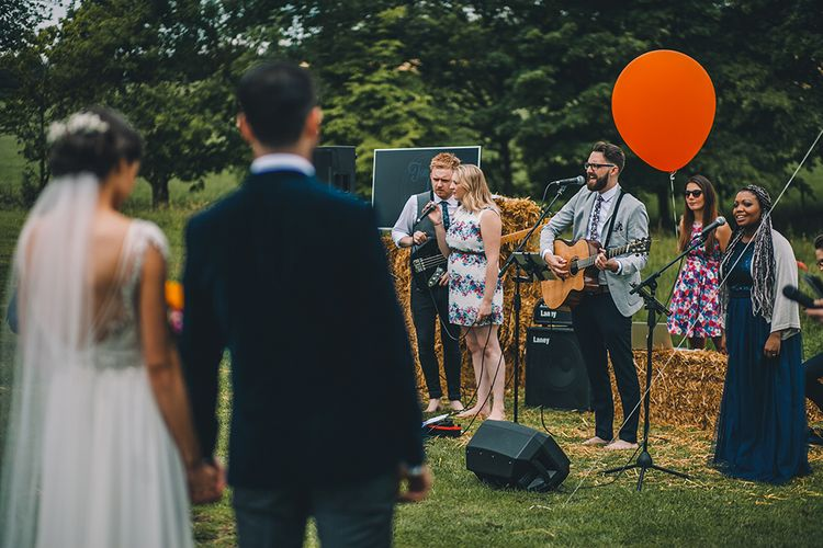 Outdoor Summer Wedding With Bright Colour Scheme With Colourful Homemade Decor And Images From Story + Colour Photography