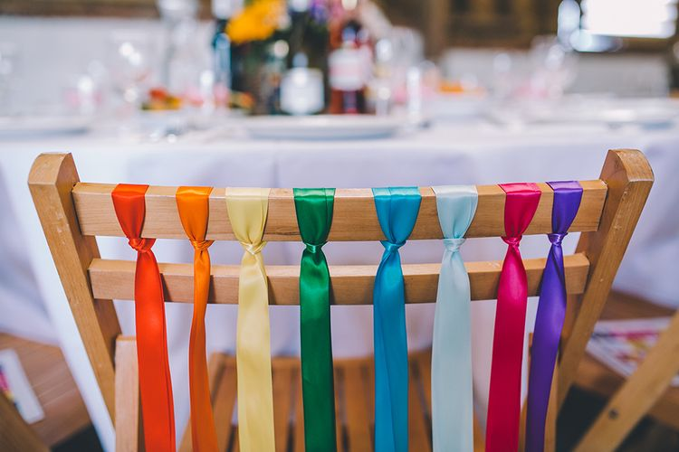 Rainbow Ribbon Details On Chairs For Wedding // Outdoor Summer Wedding With Bright Colour Scheme With Colourful Homemade Decor And Images From Story + Colour Photography