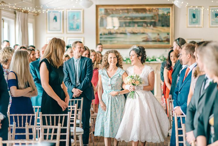 Vegan Wedding Reception With Bride In 50s Style Dress At The London Rowing Club With Charity Flowers & Images by Matt Ethan Photography