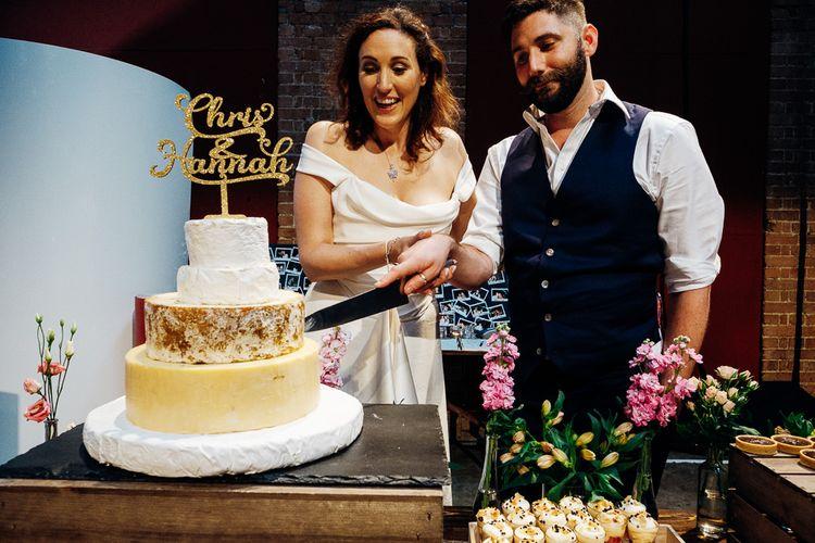 Cutting the Cake | Bride in Halfpenny Separates | Groom in Yardsmen Suit | Urban Wedding at Village Underground, London | Marianne Chua Photography