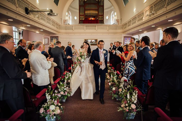 Bride in Aire Barcelona Bridal Gown & Groom in Ted Baker Church Ceremony