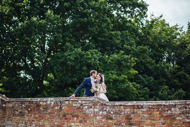 Bride in Aire Barcelona Bridal Gown & Groom in Ted Baker