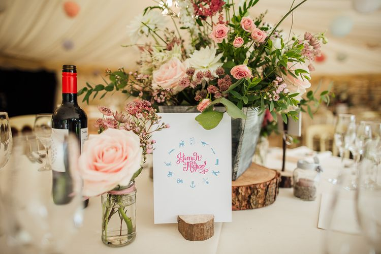 Pink Wild Flower Centrepieces on Rustic Tree Slab