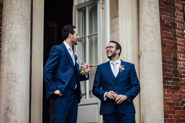 Groomsmen in Ted Baker Suits from Moss Bros hire