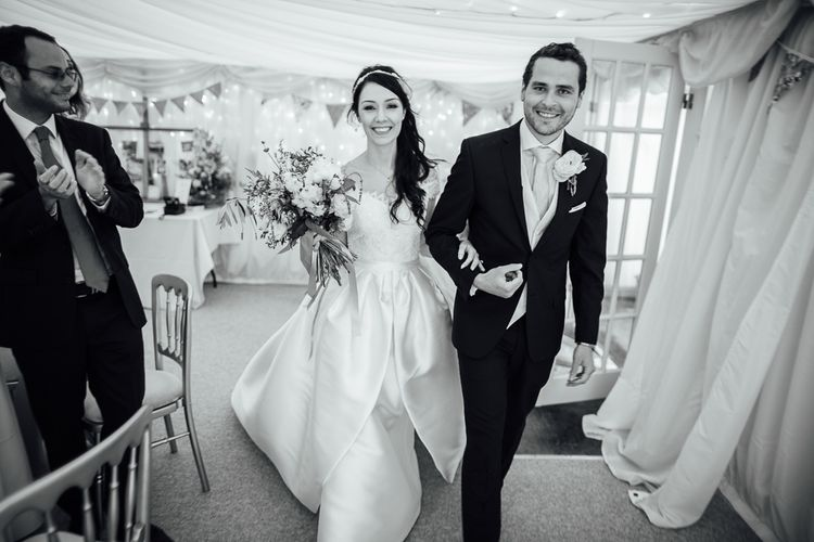 Bride in Aire Barcelona Bridal Gown & Groom in Ted Baker Suit