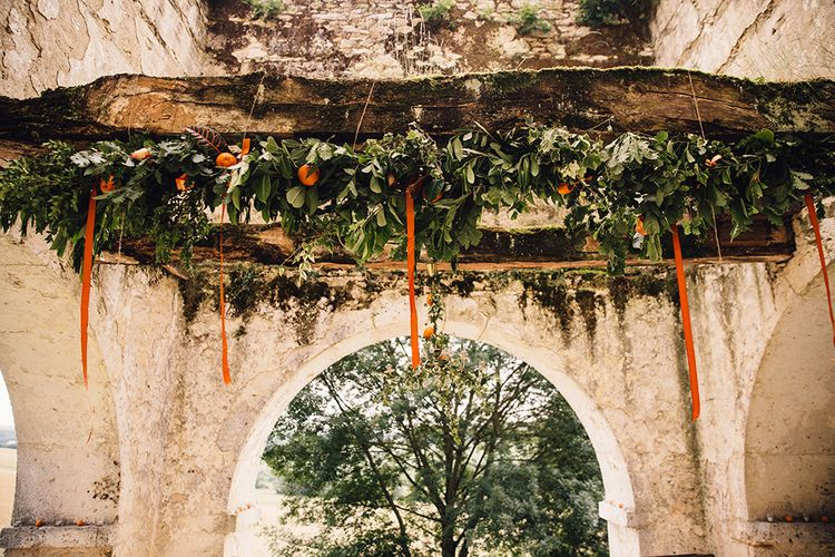 Greenery & Orange Wedding Floral Arrangement