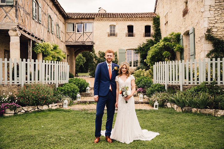 Bride in Eliza Jane Howell Gown & Groom in Navy Paul Smith Suit