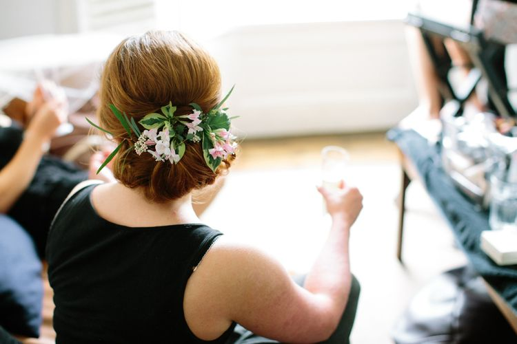 Bridesmaid Up Do with Flowers   Stylish Hackney Town Hall Wedding   Camilla Arnhold Photography   This Modern Revelry Film