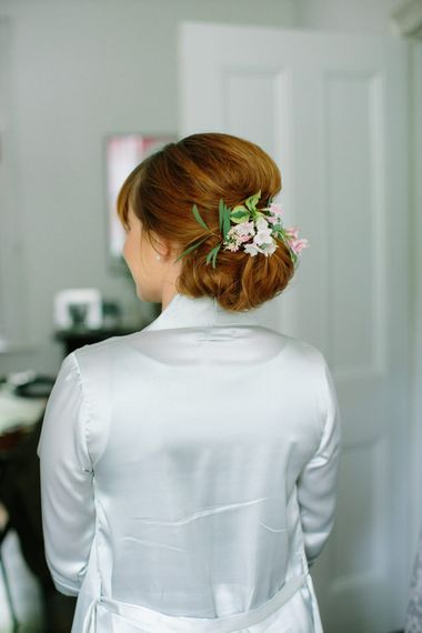 Bridesmaid Chic Chignon with Flowers   Stylish Hackney Town Hall Wedding   Camilla Arnhold Photography   This Modern Revelry Film