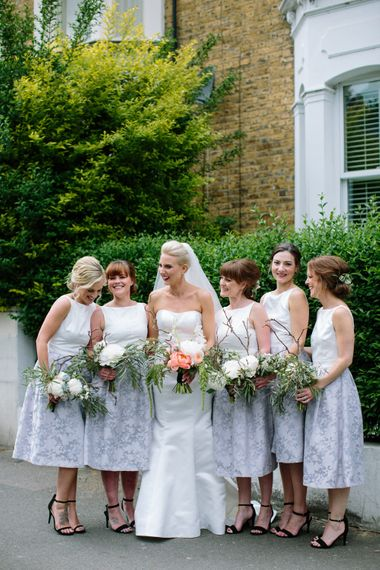 Bridesmaids in Grey & White Oasis Dresses   Bride in Anna Serrano Gown   Groom in Grey Suit   Stylish Hackney Town Hall Wedding   Camilla Arnhold Photography   This Modern Revelry Film
