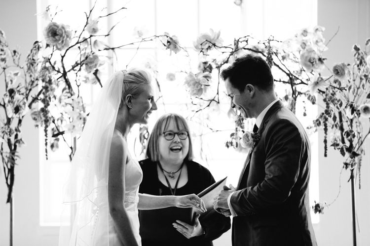Wedding Ceremony   Bride in Anna Serrano Gown   Groom in Grey Suit   Stylish Hackney Town Hall Wedding   Camilla Arnhold Photography   This Modern Revelry Film