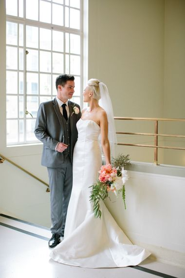 Bride in Anna Serrano Gown   Groom in Grey Suit   Stylish Hackney Town Hall Wedding   Camilla Arnhold Photography   This Modern Revelry Film