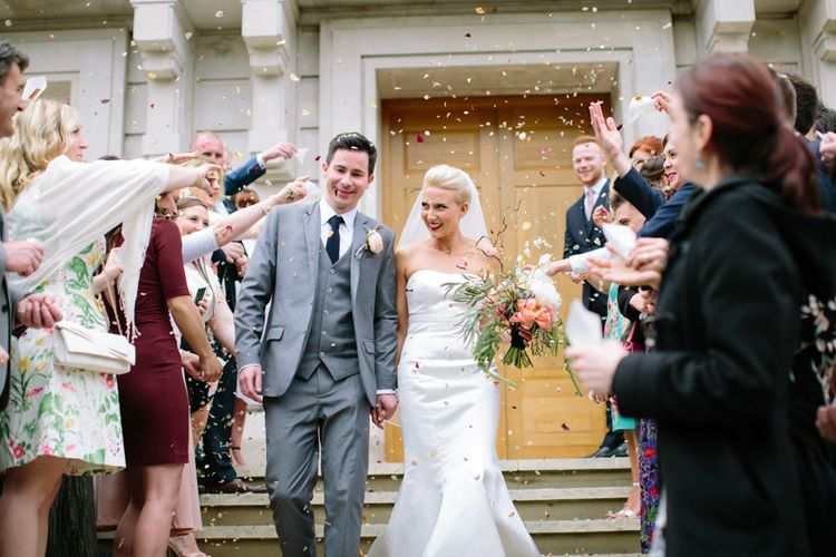Confetti Exit   Wedding Ceremony   Bride in Anna Serrano Gown   Groom in Grey Suit   Stylish Hackney Town Hall Wedding   Camilla Arnhold Photography   This Modern Revelry Film