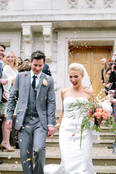 Confetti Exit   Bride in Anna Serrano Gown   Groom in Grey Suit   Stylish Hackney Town Hall Wedding   Camilla Arnhold Photography   This Modern Revelry Film