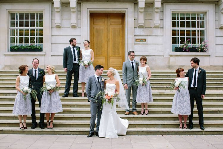 Wedding Party   Wedding Ceremony   Bride in Anna Serrano Gown   Groom in Grey Suit   Stylish Hackney Town Hall Wedding   Camilla Arnhold Photography   This Modern Revelry Film
