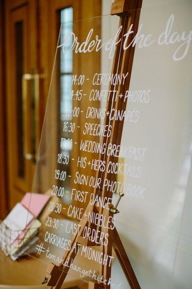 Perspex Order of The Day Wedding Sign   Stylish Hackney Town Hall Wedding   Camilla Arnhold Photography   This Modern Revelry Film