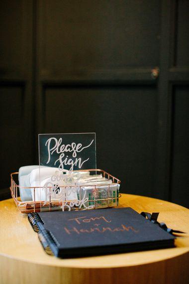 Perspex Polaroid Station Sign   Stylish Hackney Town Hall Wedding   Camilla Arnhold Photography   This Modern Revelry Film