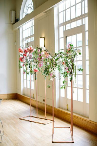 Copper Arch with Blush Magnolia Branch Decor   Stylish Hackney Town Hall Wedding   Camilla Arnhold Photography   This Modern Revelry Film