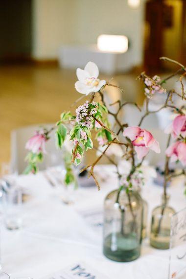 Magnolia Branch Centrepieces   Stylish Hackney Town Hall Wedding   Camilla Arnhold Photography   This Modern Revelry Film