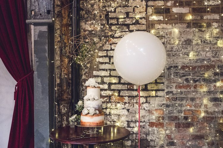 White & Copper Wedding Cake with Giant Balloon | Contemporary City Wedding at People's History Museum & Hope Mill Theatre, Manchester Planned by Alternative Weddings MCR | Babb Photography