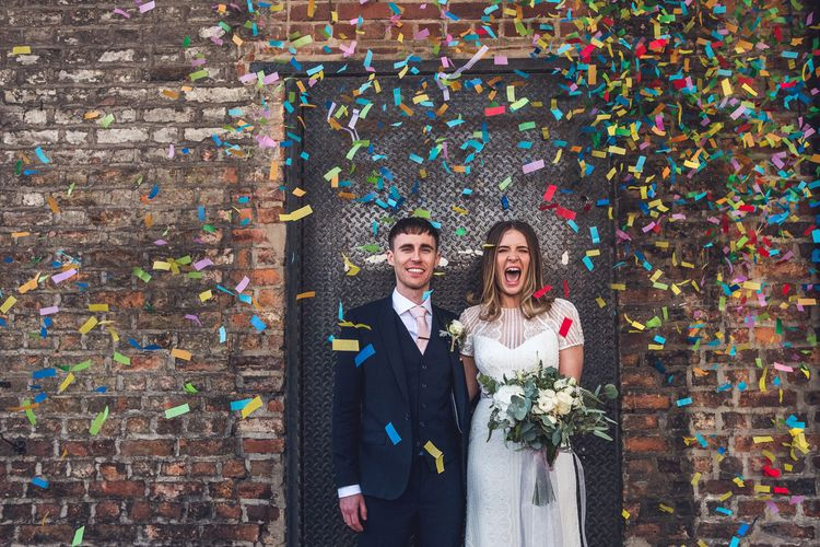 Confetti Moment | Bride in Leonora Watters Gown | Groom in Navy Suit | Contemporary City Wedding at People's History Museum & Hope Mill Theatre, Manchester Planned by Alternative Weddings MCR | Babb Photography