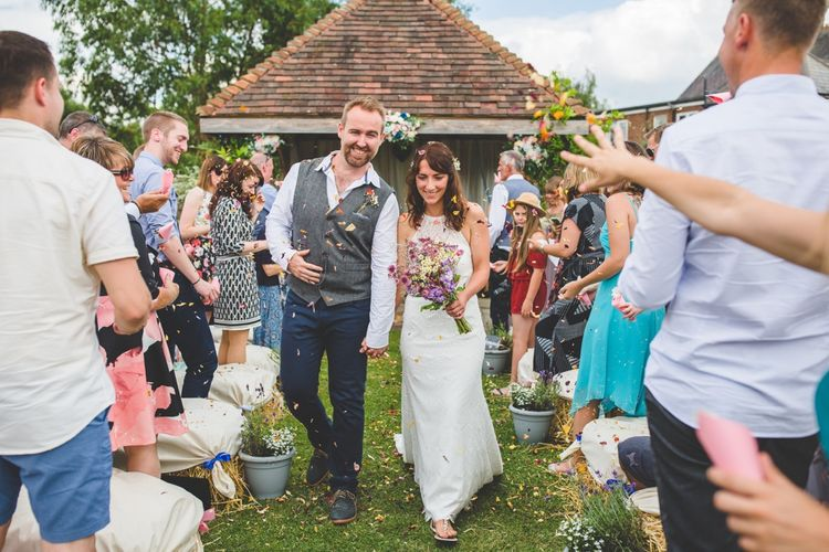 Outdoor Wedding Ceremony // Festival Inspired DIY Wedding With Relaxed Dress Code Hay Bale Seating For Ceremony And Garden Games With Images From Livvy Hukins Photography