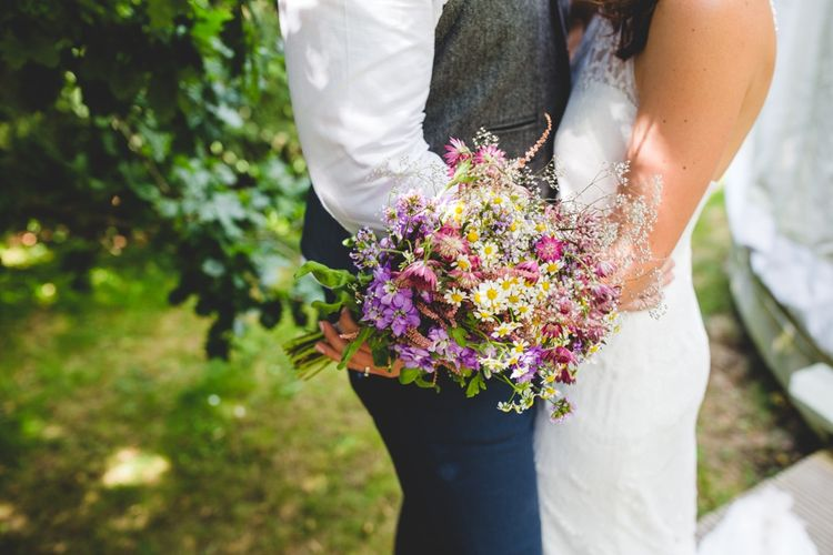 Wild Flower Wedding Bouquet // Festival Inspired DIY Wedding With Relaxed Dress Code Hay Bale Seating For Ceremony And Garden Games With Images From Livvy Hukins Photography