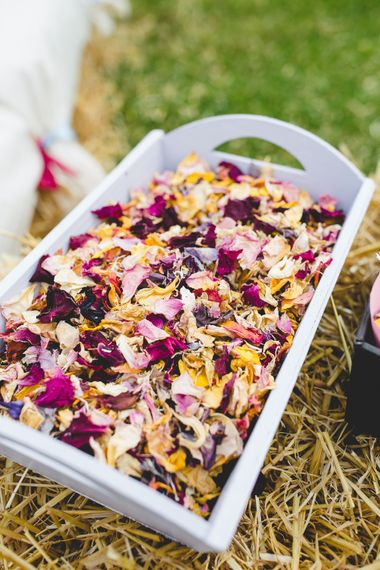 Dried Flower Petal Confetti // Festival Inspired DIY Wedding With Relaxed Dress Code Hay Bale Seating For Ceremony And Garden Games With Images From Livvy Hukins Photography