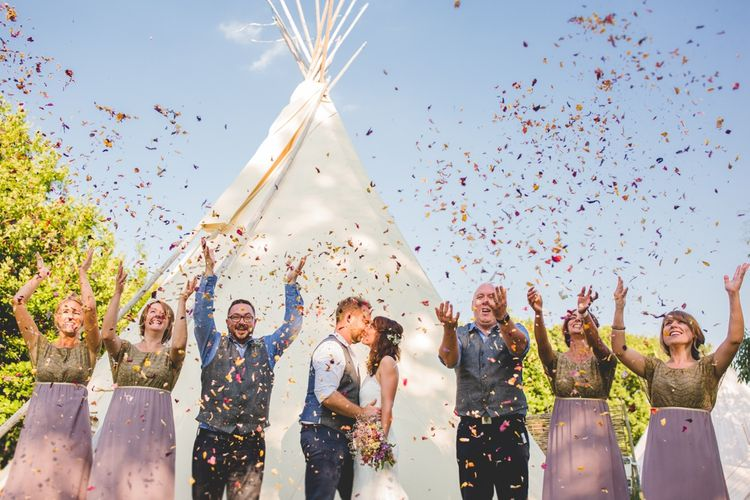 Confetti Shot // Festival Inspired DIY Wedding With Relaxed Dress Code Hay Bale Seating For Ceremony And Garden Games With Images From Livvy Hukins Photography