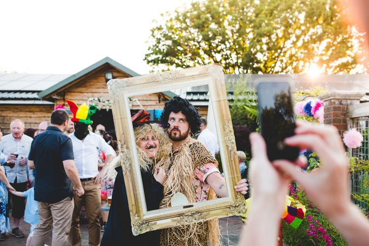 DIY Photo Booth For Wedding // Festival Inspired DIY Wedding With Relaxed Dress Code Hay Bale Seating For Ceremony And Garden Games With Images From Livvy Hukins Photography