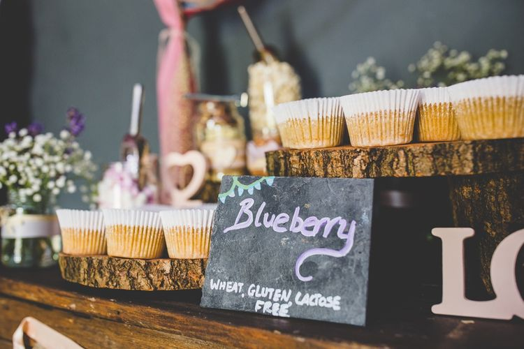 Cake Table At Wedding // Festival Inspired DIY Wedding With Relaxed Dress Code Hay Bale Seating For Ceremony And Garden Games With Images From Livvy Hukins Photography