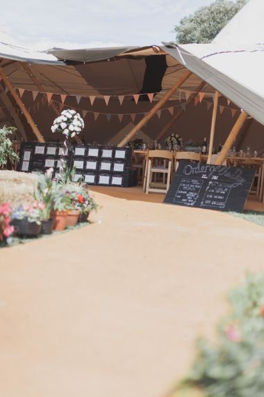 Outdoor Wedding Ceremony With Haybale Seating & Chalkboard Sign