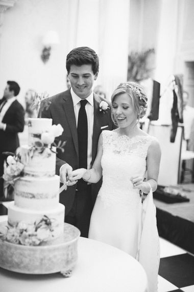 Cutting the Cake | Bride in Pronovias Gown | Groom in Navy J.Crew Suit | Elegant, Pastel Wedding at Hedsor House, Buckinghamshire | M & J Photography | Shoot It Yourself Films
