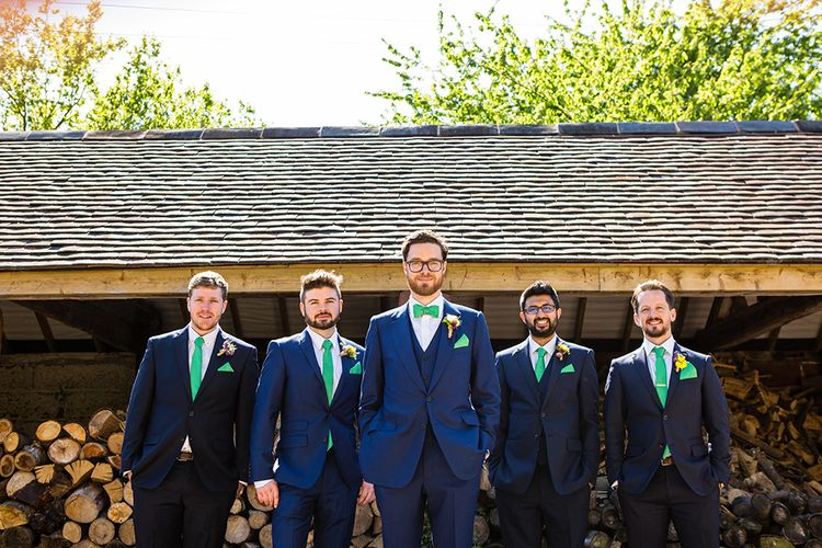 Groom & Groomsmen in Navy With Green Bowties