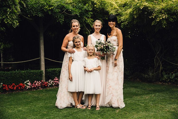 Bridesmaids in Floral Jenny Yoo Dresses from Coco and Kate Boutique