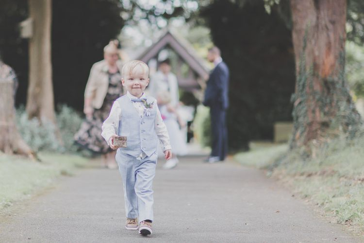 Page Boy in Pale Blue Trousers, Waistcoat & Bow Tie
