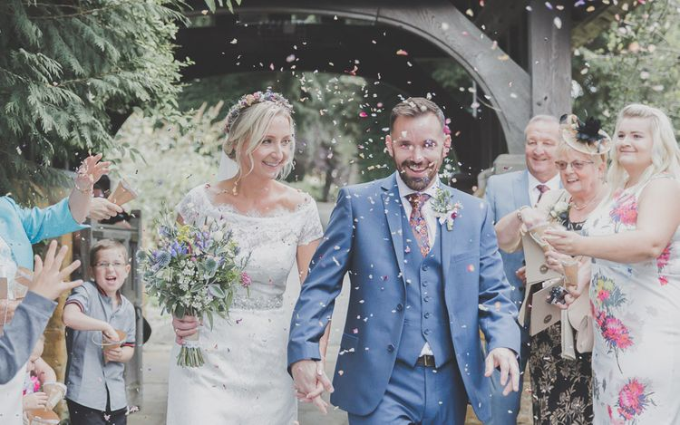 Confetti Moment with Bride in Lace Sincerity Bridal Wedding Dress & Groom in Blue Ted Baker Suit