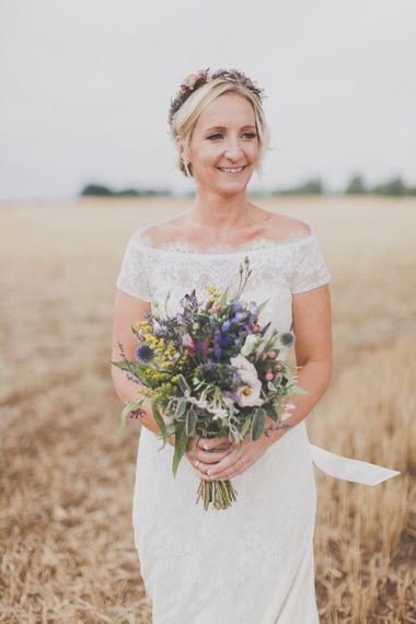 Bride in Lace Sincerity Bridal Wedding Dress & Wild Flower Bouquet