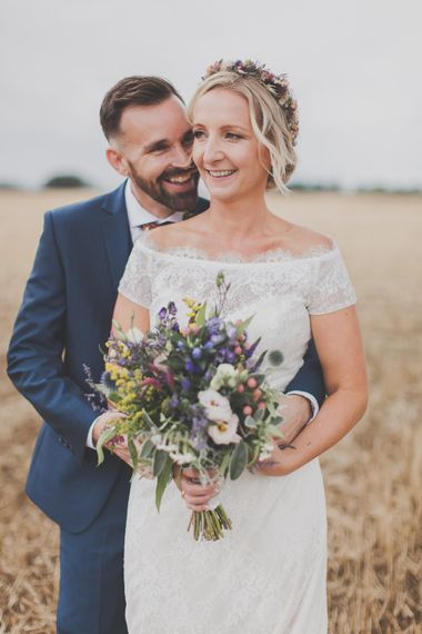 Bride in Lace Sincerity Bridal Wedding Dress & Groom in navy Ted Baker Suit