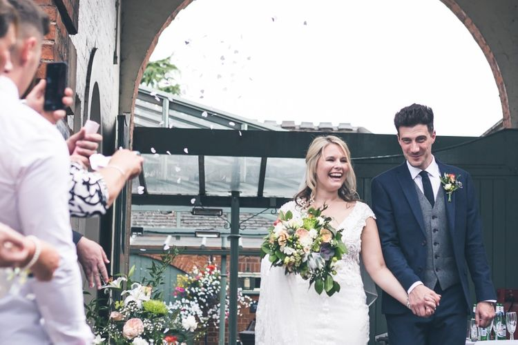 Confetti Moment | Bride in Lace The Signature Collection Bridal Gown from Wed2b | Groom in Limehaus Suit | Classic Wedding at The Mytton & Mermaid, Atcham | Willo Photography