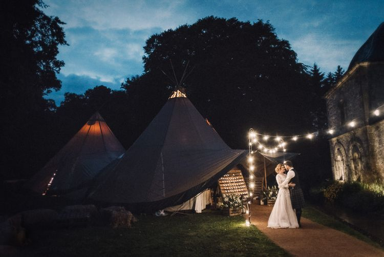Festoon Lights For A Tipi Wedding // Rainy Tipi Wedding At The Coach House at Kinross House Scotland With Bride In Embellished Bespoke Dress And Images From Photos By Zoe
