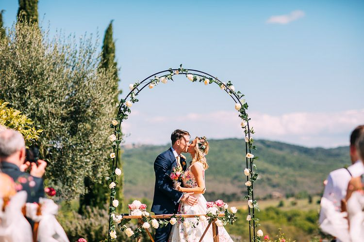 Floral Arch Altar | Bride in Charlotte Balbier Untamed Love Floral Wedding Dress | Groom in Navy Ted Baker Suit | Destination Wedding at Casa Cornacchi in Italy | Albert Palmer Photography