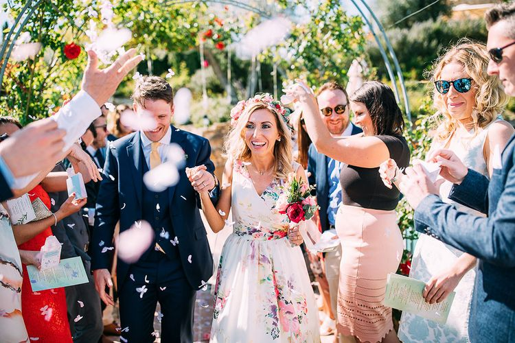 Confetti Moment | Bride in Charlotte Balbier Untamed Love Floral Wedding Dress | Groom in Navy Ted Baker Suit | Destination Wedding at Casa Cornacchi in Italy | Albert Palmer Photography