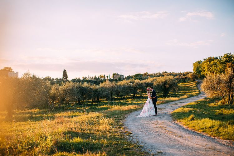 Bride in Charlotte Balbier Untamed Love Floral Wedding Dress | Groom in Navy Ted Baker Suit | Destination Wedding at Casa Cornacchi in Italy | Albert Palmer Photography