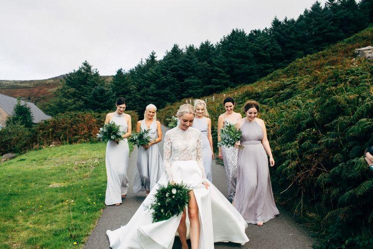 Bride in Emma Beaumont Wedding Dress with Grey Bridesmaids