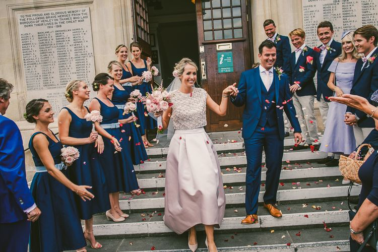 Confetti Exit | Bride in Separates by Suzannah | Groom in Navy Laurence Menswear Suit | Nautical At Home Marquee Wedding by 81 Events | RS Brown Photography