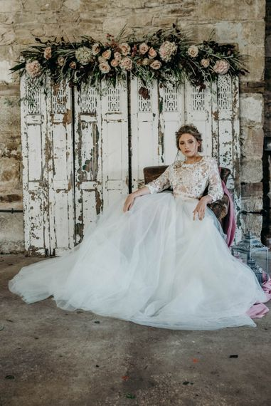 Bride in Gown from Te Amo Brides | Floral Adorned Screen | Industrial Luxe Inspiration | Clare Kinchin Photography