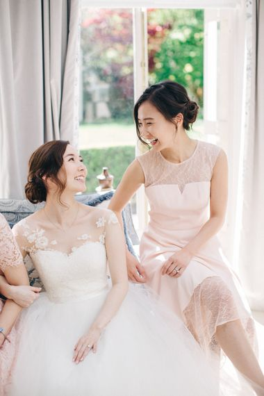 Bride in Bespoke Illusion Neck Gown & Bridesmaid in Pale Pink Dress | M and J Photography