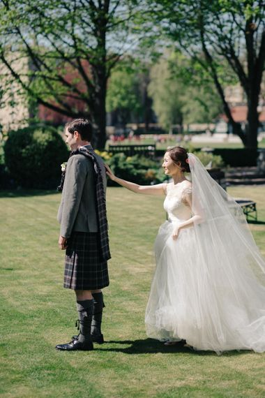 First Look | Bride in Bespoke Illusion Neck Gown | Groom in Tartan Kilt | M and J Photography