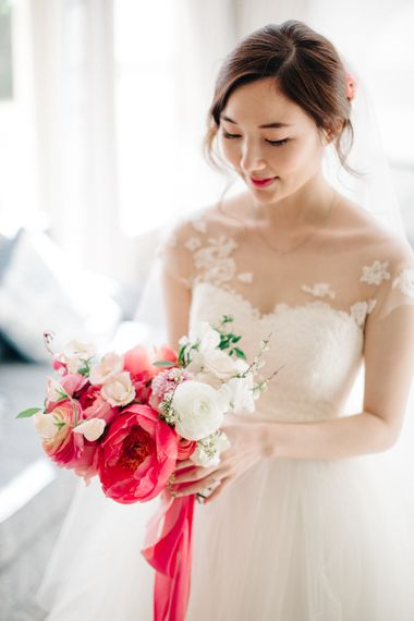 Bride in Bespoke Gown with Coral Peony & Ranunculus Bouquet | M and J Photography